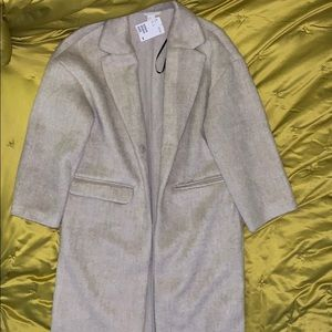 Knee length Creme colored trench like coat